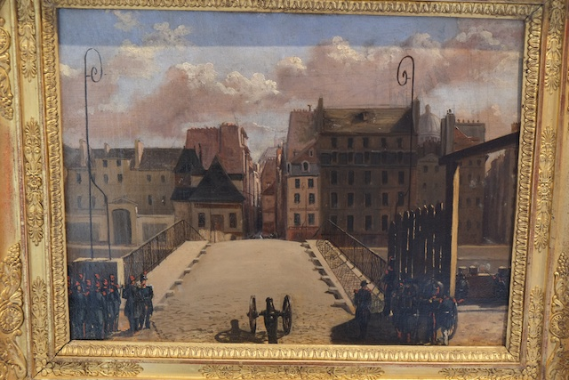 Our Paris apartment is in the building to the right of the bridge, shown in this painting done at the time of the Paris Commune.