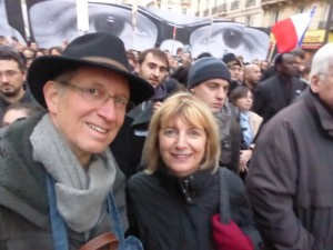 Hugh and Brenda marching down Boulevard Voltaire. Eyes of Stephane Charbonner, murdered editor of Charlie Hebdo, are on the poster behind us.