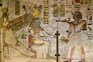 Ramses III making an offering to Osiris and Isis