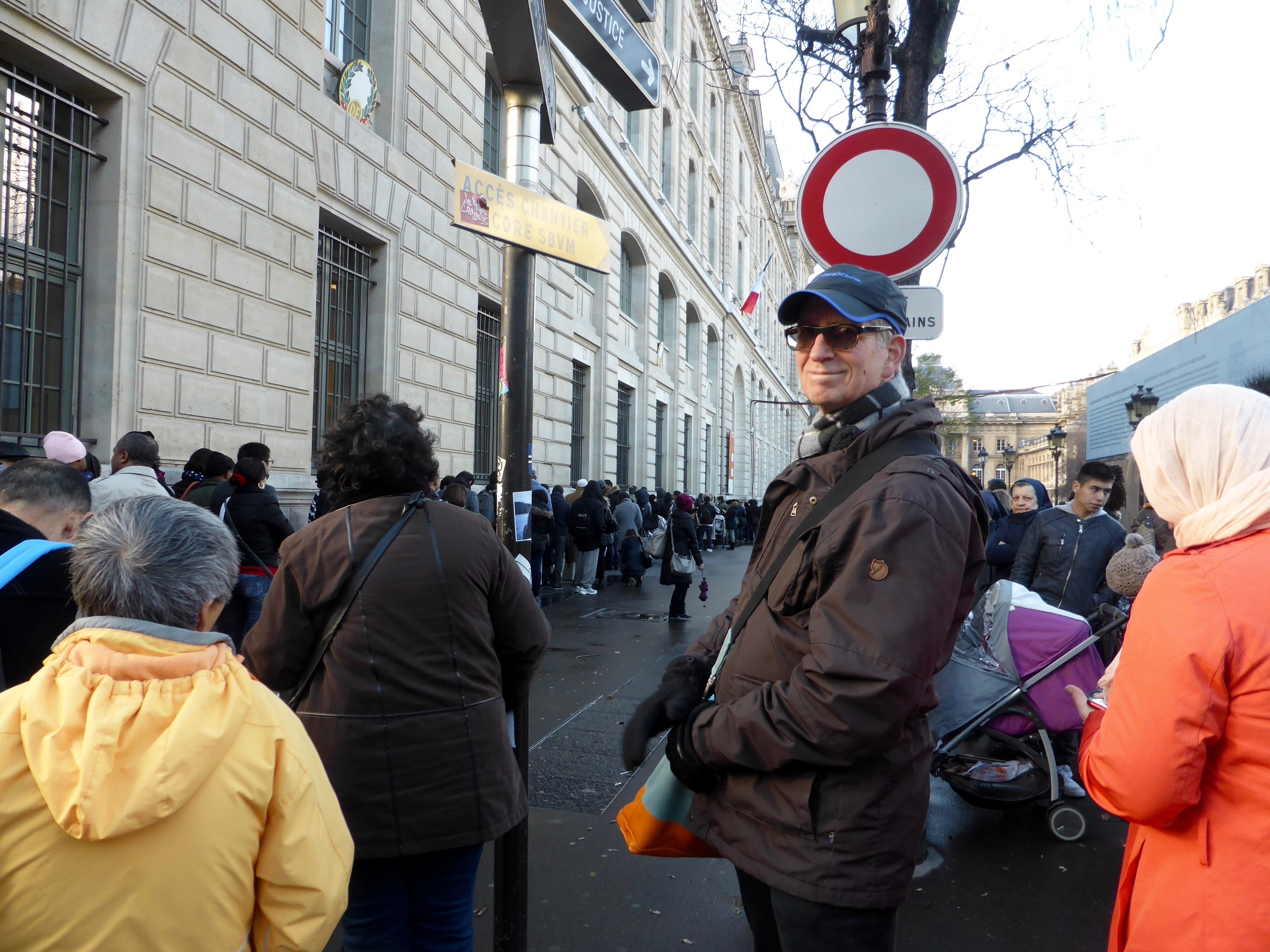 Hugh standing in front of the Prefecture de Police, Paris